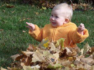 infant in leaves