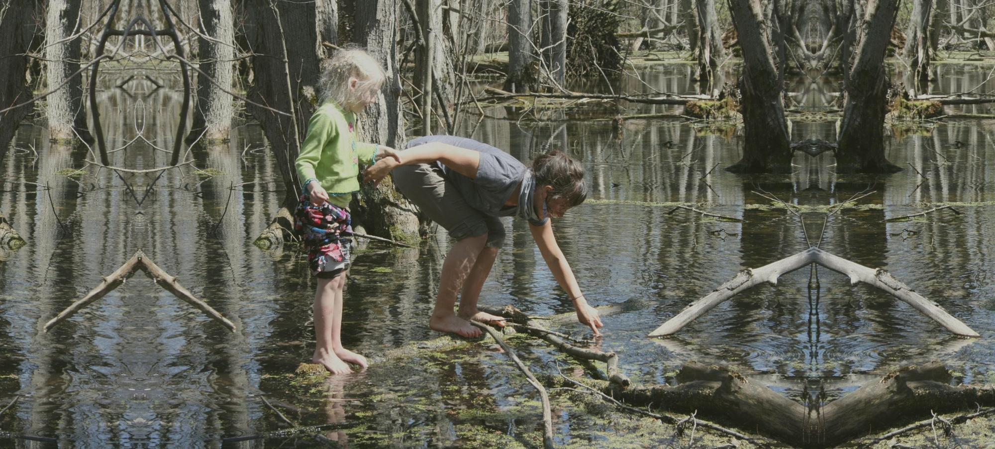 mother and child exploring a wetland